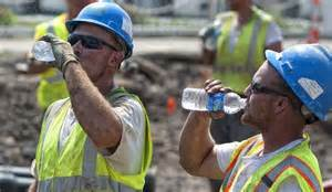 Worker drinking water
